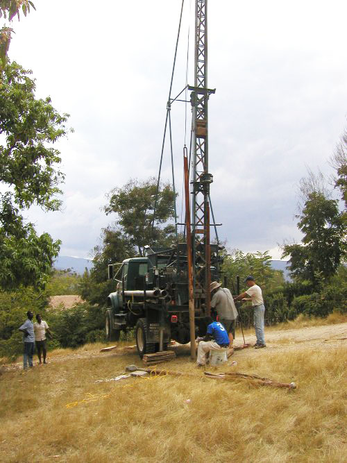 Glenn, Doug, and Michelin set up to begin drilling a well